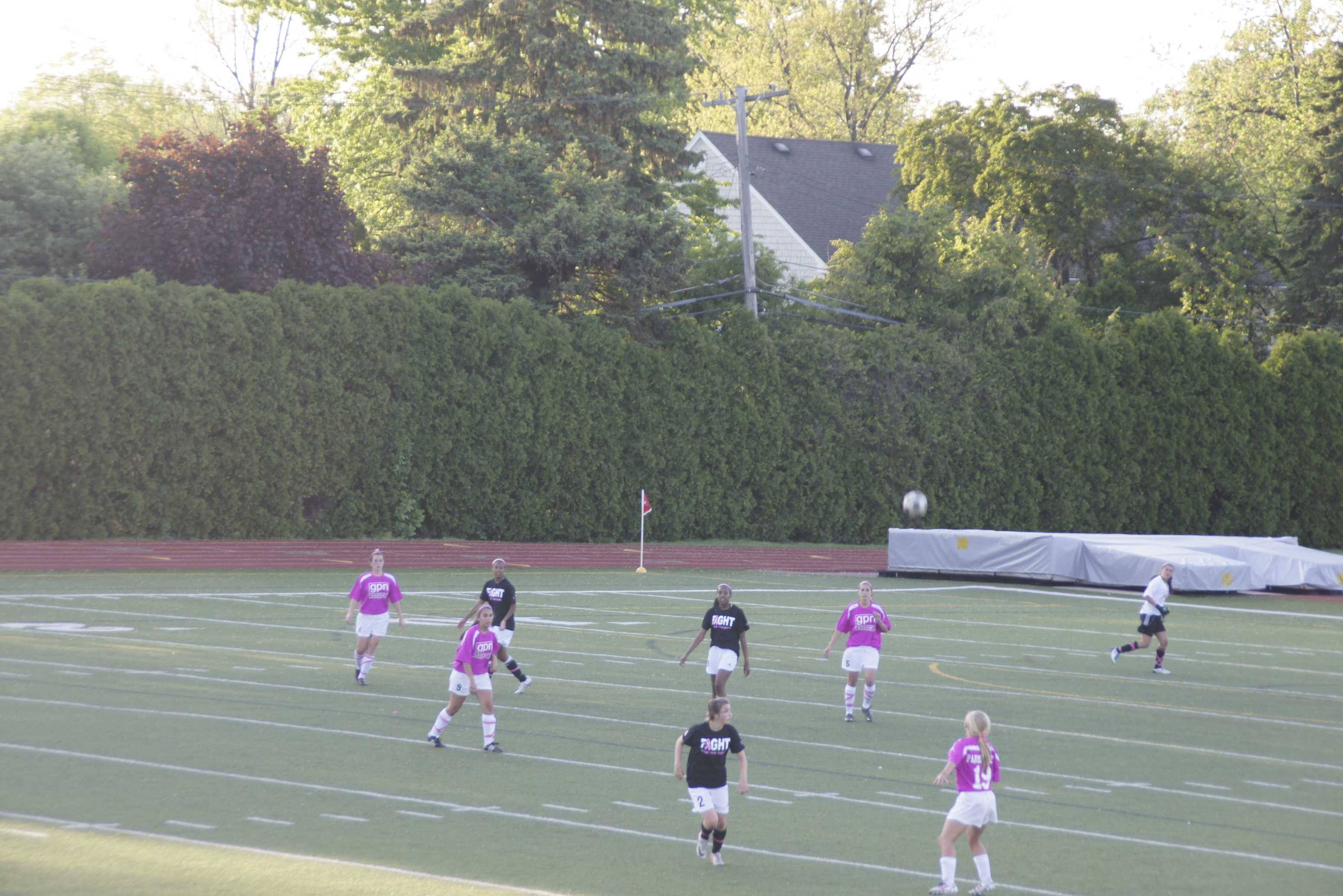 Photo by KELLY CULLEN '13 | Staff Writer. North and South's varsity soccer teams played against each other to help spread awareness to breast cancer.