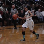 Aliezza Brown '15 dribbling to the basket