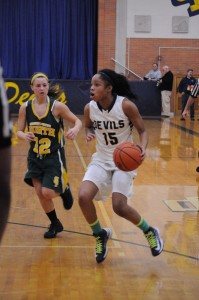 Bre'nae Andrews '14 taking the ball on the inside