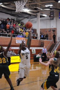 Cierra Rice '15 going up for the basket