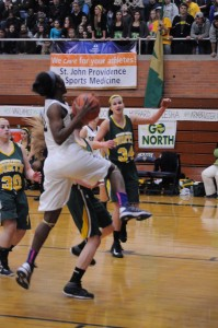 Cierra Rice '15 going up for the bucket