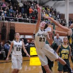 Claire DeBoer '13 shooting a basket