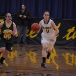 Katie Kish '15 dribbling up court