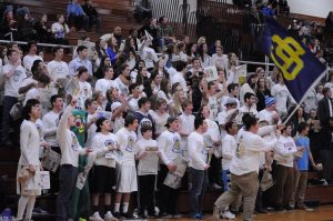 Students supported their blue devils in all white