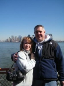 Jeff Nardone and wife DeEtte pose for a photograph near the water.
