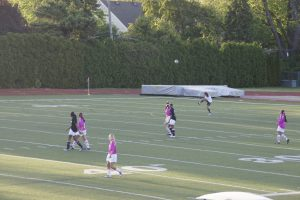Photo by KELLY CULLEN '13 | Staff Writer. North and South varsity soccer teams compete to bring awareness to breast cancer.