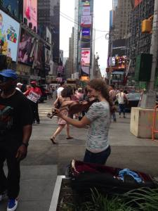 Alyssa playing in Time Square